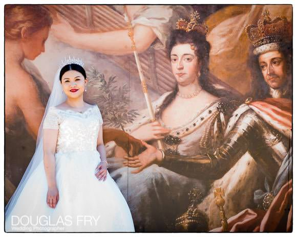 Bride photographed next to Painted Hall Ceiling murial