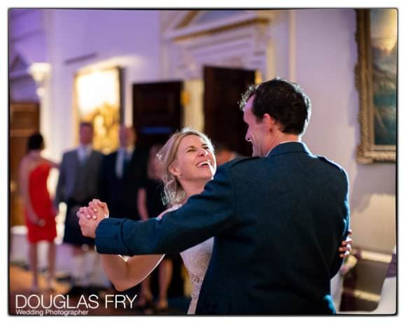 Couple dancing at end of wedding day - photographed on Leica cameras