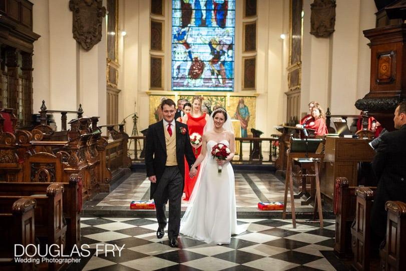 Bride and groom leaving church - wedding photograph