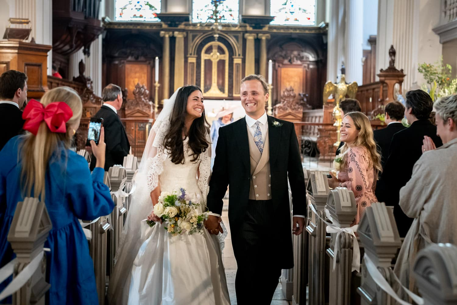 Bride and groom photographed in London church