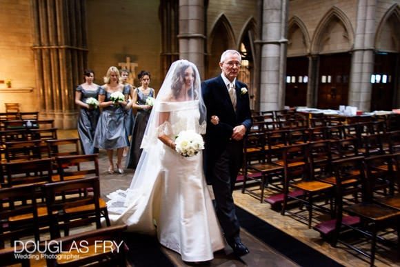 Wedding Photographer at St Columbas Catholic Church in Spanish Place, London - Father and bride walking down aisle