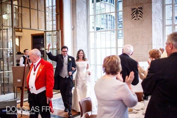 Couple entering wedding breakfast at RIBA