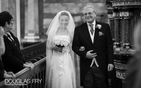 Wedding photograph in black and white of bride and father in Synangogue