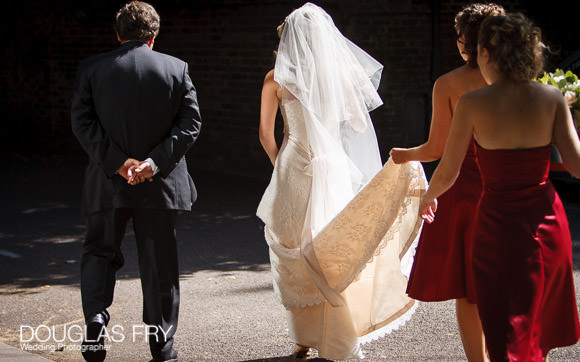 Bride entering HTB for wedding service in London