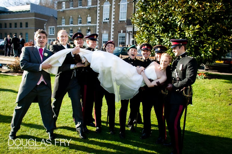 bride with ushers and groom - wedding photograph