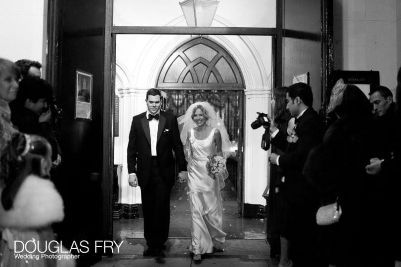 Bride and groom photographed leaving St Pauls Knightsbridge