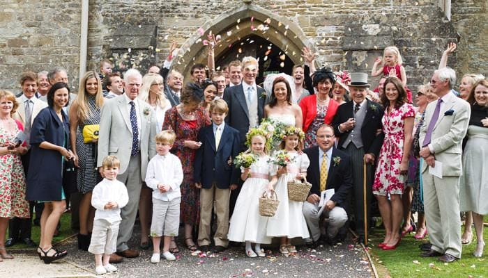 Wedding Photograph of Everyone outside the Church in Avening Gloucestershire
