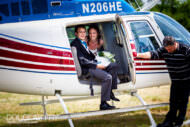 Bride and groom photographed arriving by helicopter for wedding reception in Dorset