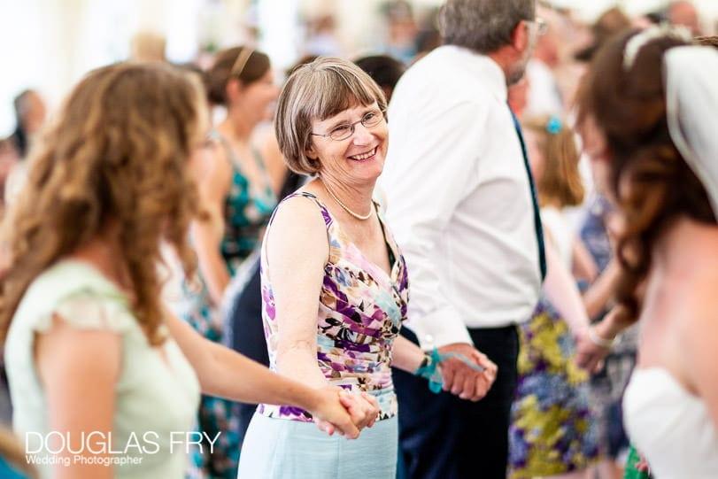 Guests at wedding reception dancing