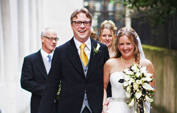 Wedding Photograph of Beth and Alex leaving St Bride's Church, London