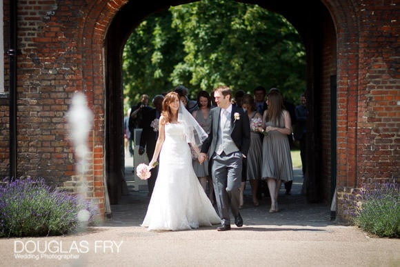 Bride and groom photographed entering grounds of Fulham Palace in London