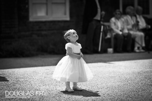 Black and white photograph of child at fulham palace