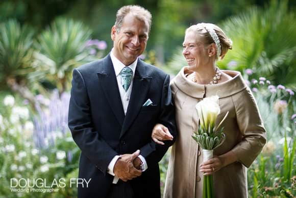 Bride and groom photographed together in Chelsea Physic Garden