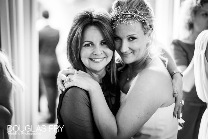 Bride photographed with friend during wedding day