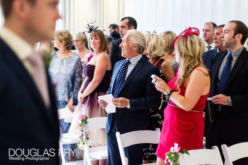 Guests waiting for bride at wedding at Coworth Park