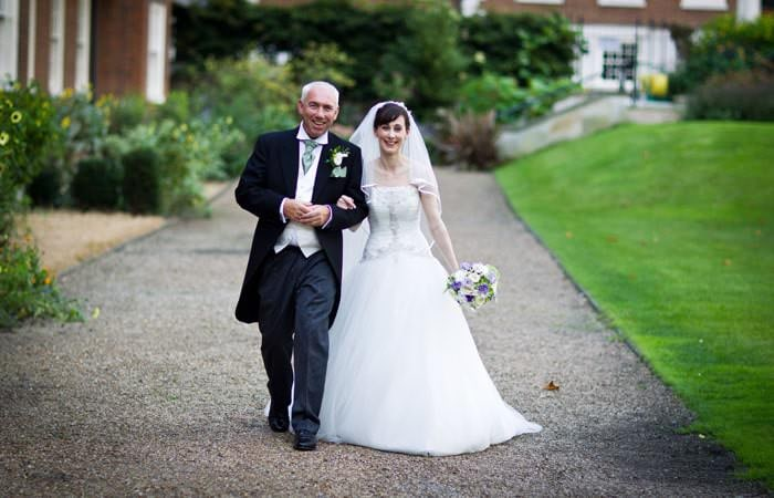 Bride and Groom Photographed at Wedding at St Etheldredas London
