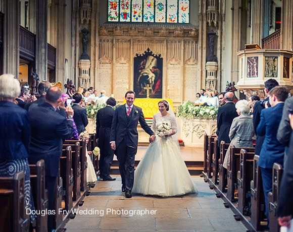 Bride and groom walking down the aisle at St Luke's Church Chelsea to leave the church