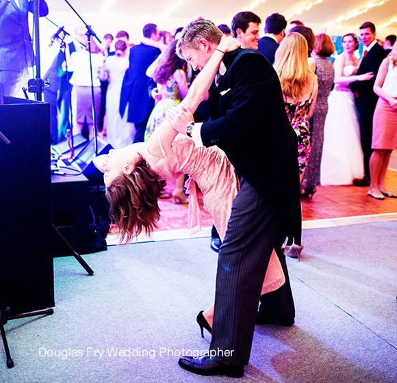 Guests dancing at Chiswick House in marquee photographed by Douglas Fry