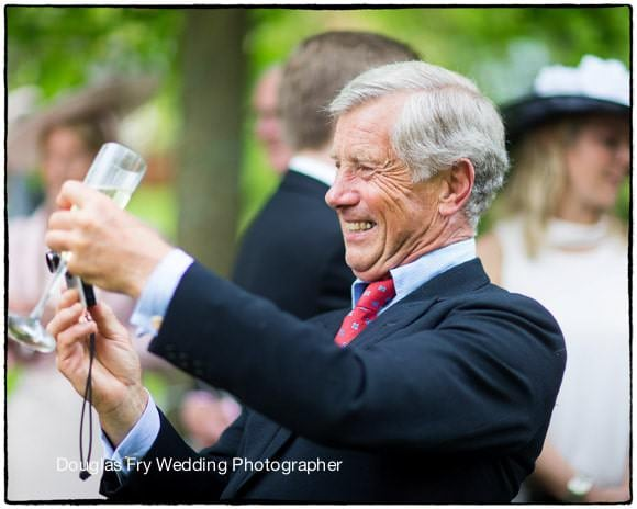 Wedding Photography of father with camera in Hampshire