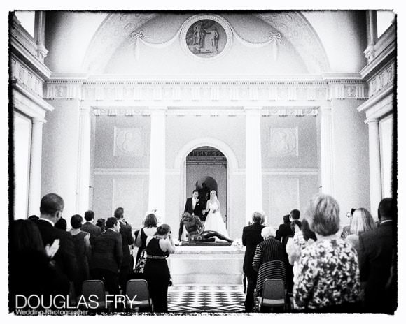 Wedding Photograph of bride and groom at end of wedding ceremony in black and white