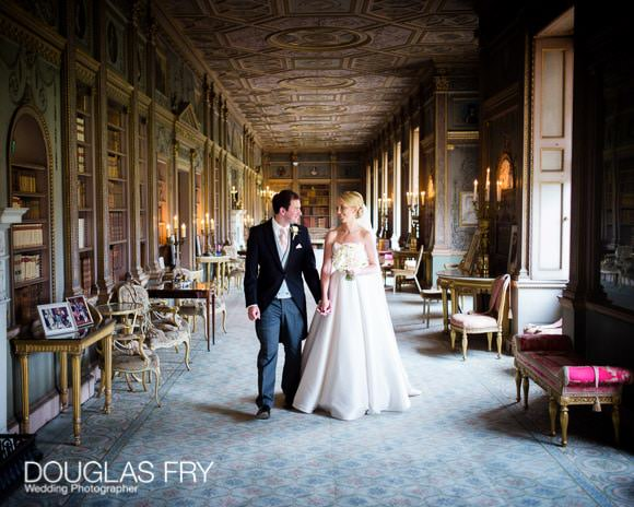 Bride and groom walking through Syon House