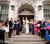Photograph of bride and groom on steps of register office after wedding ceremony in London