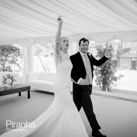 Bride and groom entering marquee for wedding breakfast