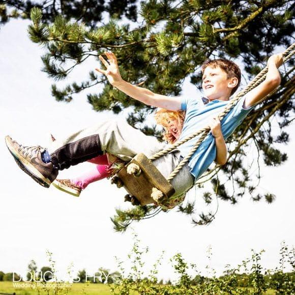 Photograph of children on swing in Garden
