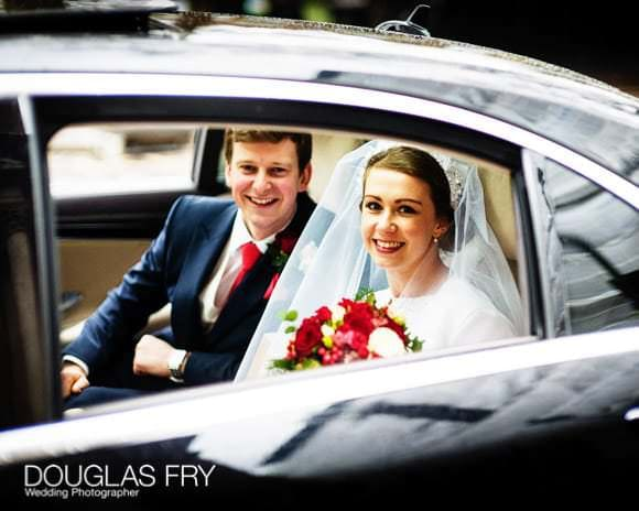 couple in car leaving church for the wedding reception venue - In and Out club