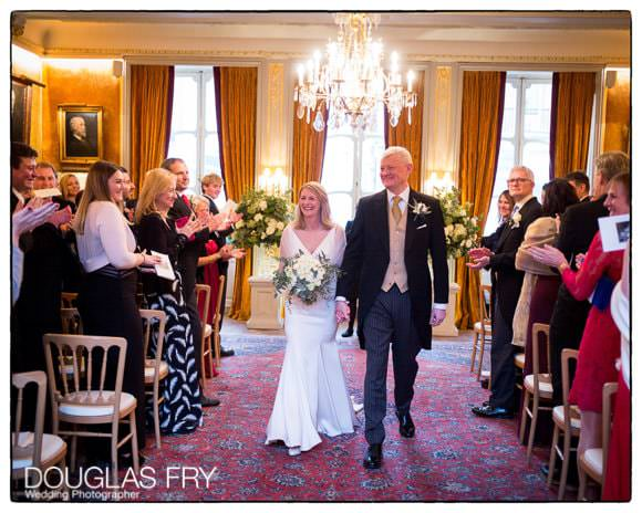 Bride and groom at end of wedding ceremony at Savile Club in London