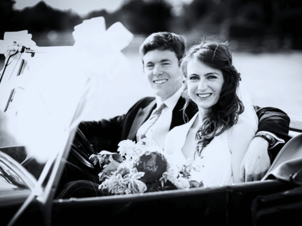 Couple photographed in vintage car leaving wedding church service