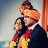 Hindu engagement ceremony - couple listening
