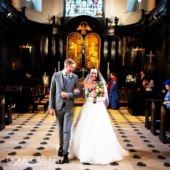 Bride and Groom walking down aisle at end of wedding ceremony in London