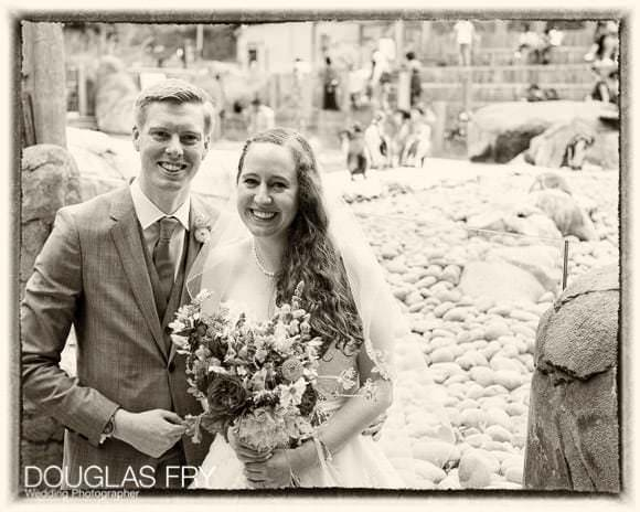 Couple in black and white at London Zoo during wedding reception