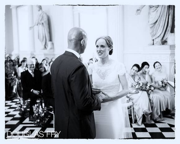 Bride and groom exchanging vows - black and white photograph at Syon House