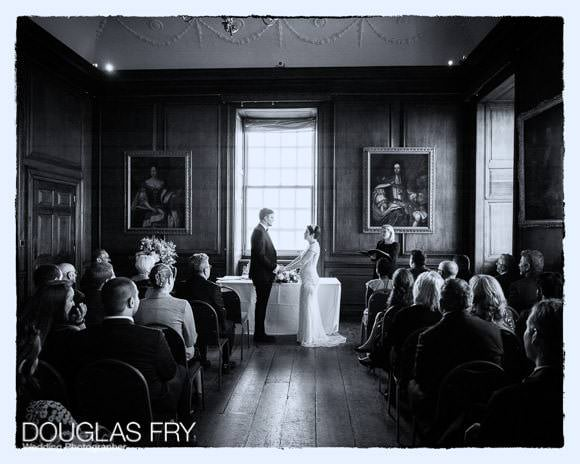 Wedding at the Admiral's House in Greenwich - bride and groom during ceremony