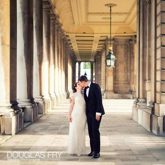Couple photographed outside the Old Royal Naval College in London
