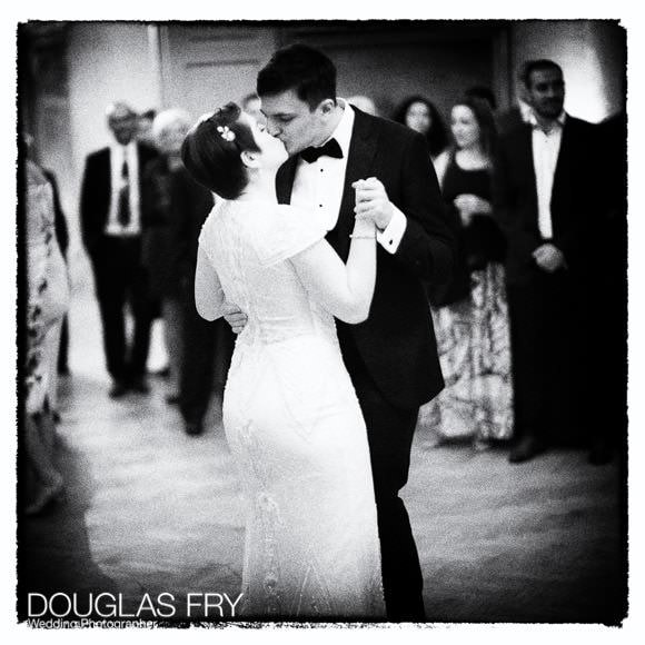 Black and white photograph taken on Leica of couple dancing at The Admiral's House in Greewich