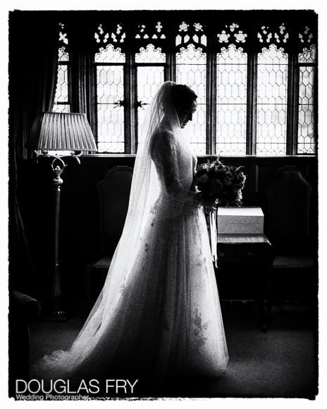Bride in black and white at Hever Castle in Kent