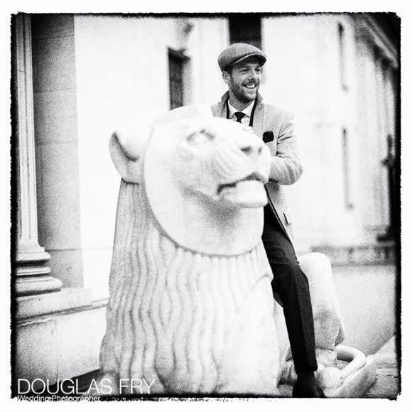 Wedding guest on lion in front of register office in black and white - Leica photograph