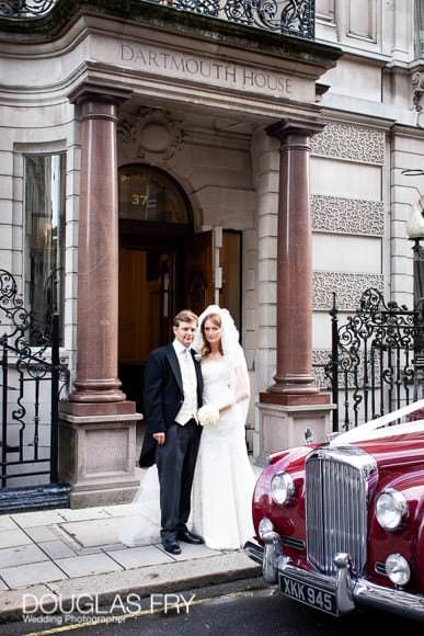 Bride and groom photographed in front of London venue