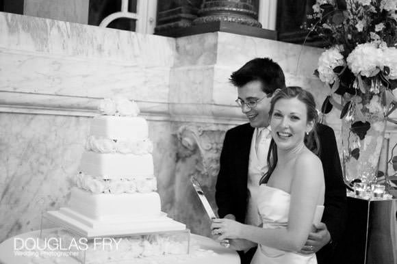 Cutting the cake during wedding in London