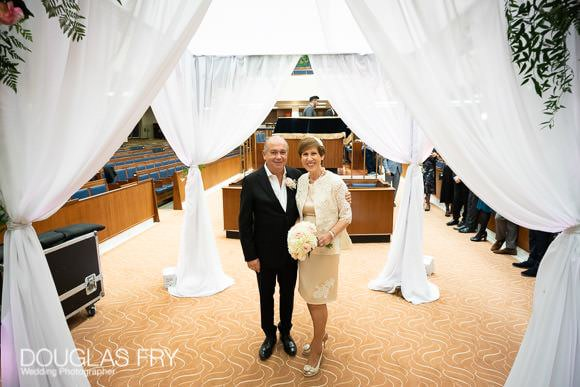 wedding photograph of the couple under the chuppah in London synagogue