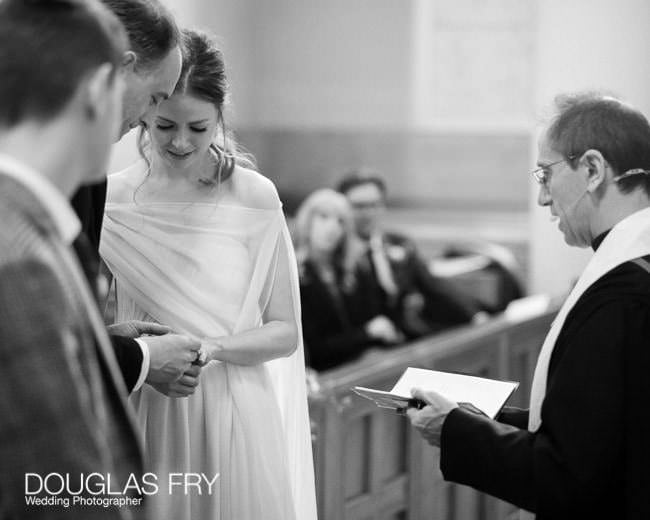 Couple exchanging vows in London church