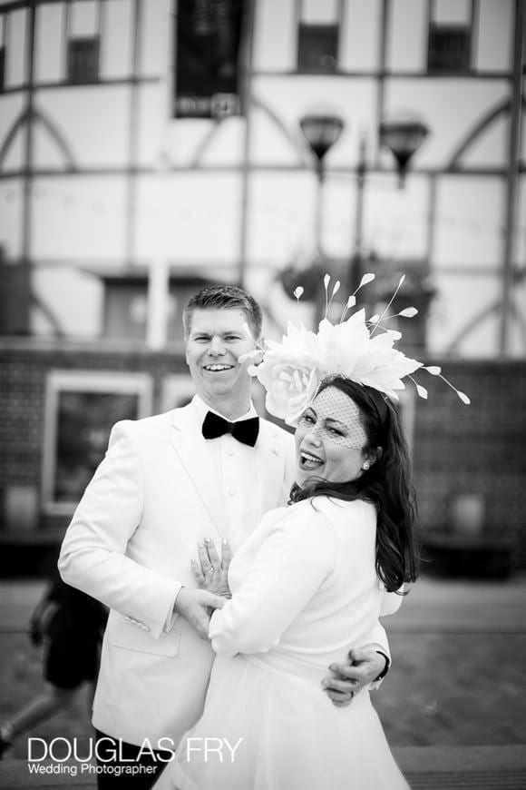 Wedding couple pose next to Shakespeare's Globe on London's South Bank