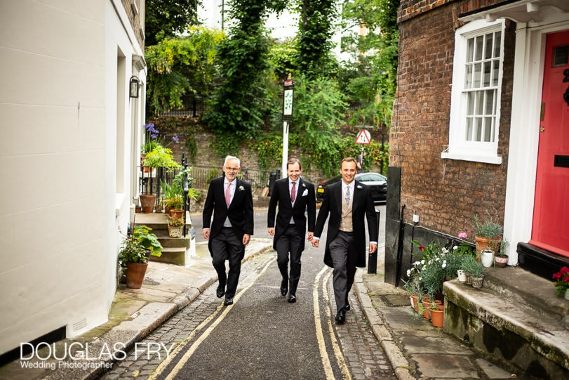 Groom and best men in Hampstead on way to wedding photographed by Douglas Fry wedding photographer
