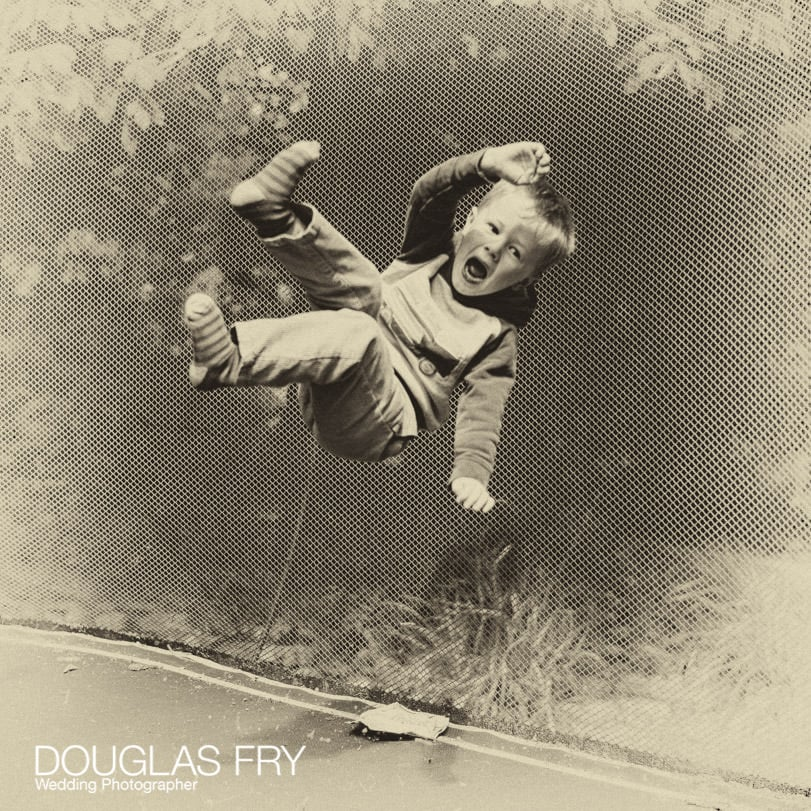 Trampoline photograph of child playing at home in Berkshire