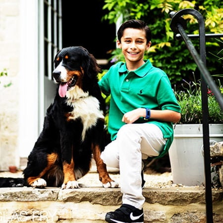 Son with dog photographed at home