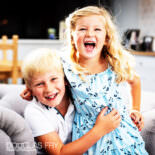 Children photographed at home in London playing together