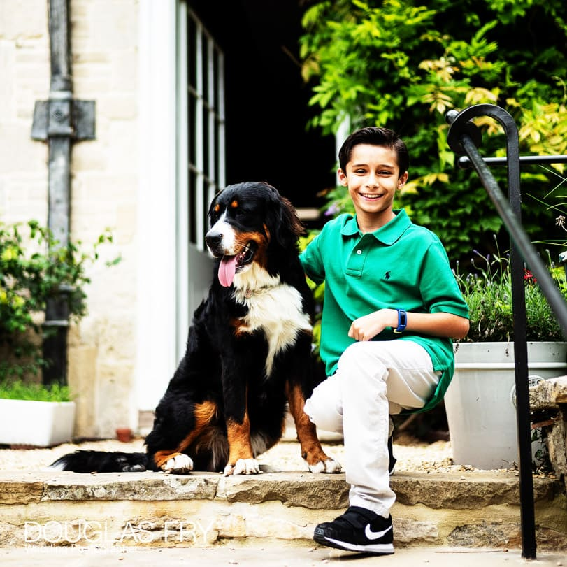 Boy photographed with the dog at home